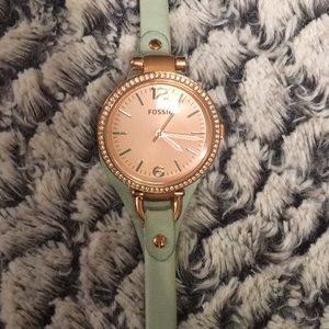 Stunning mint green watch with a rose gold face
